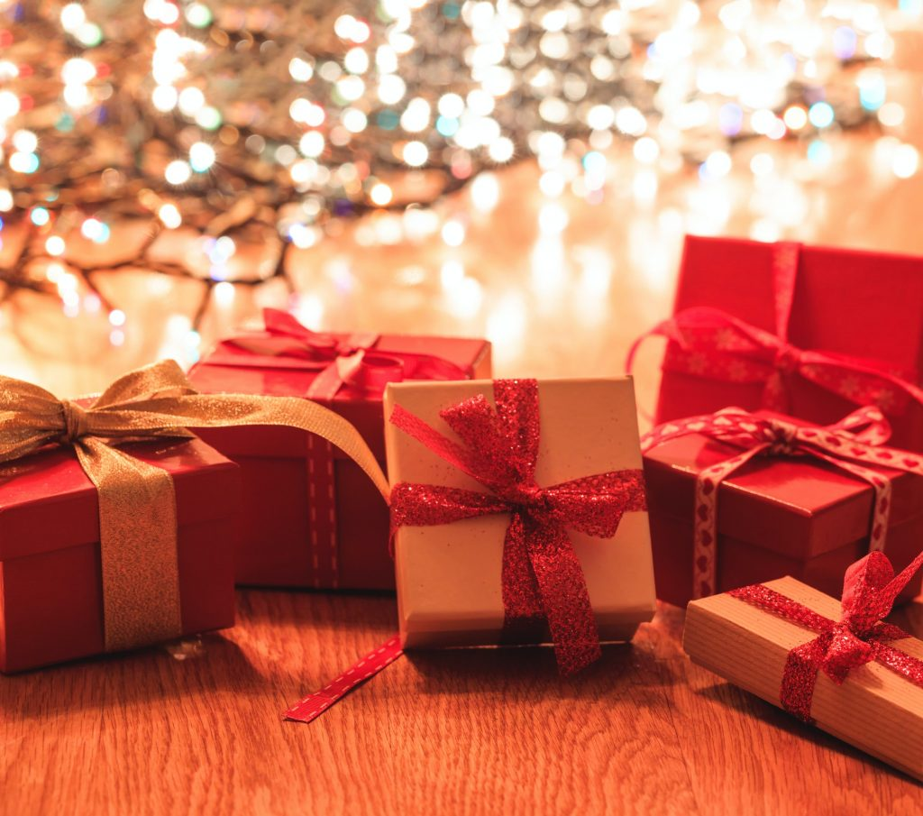 Christmas Christmas gifts on wooden floor, xmas lights bokeh background